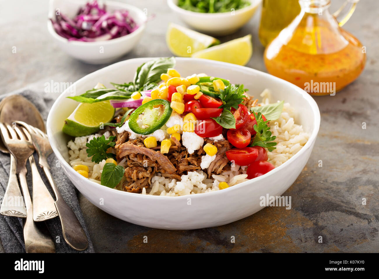 Dinner bowl with rice and pulled pork - Stock Image