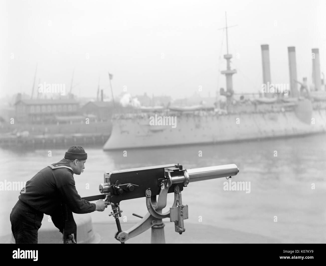 Sailor firing machine gun at Brooklyn Navy Yard, New York City, USA     Date: 1901 Stock Photo