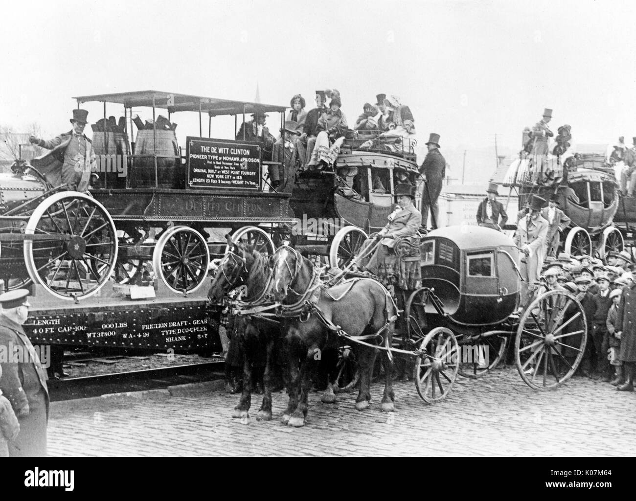 Horse drawn carriage and train. The De Witt Clinton, pioneer type of Mohawk & Hudson, first to haul passenger train in state of New York ... ' on train in America.     Date: circa 1920 - Stock Image