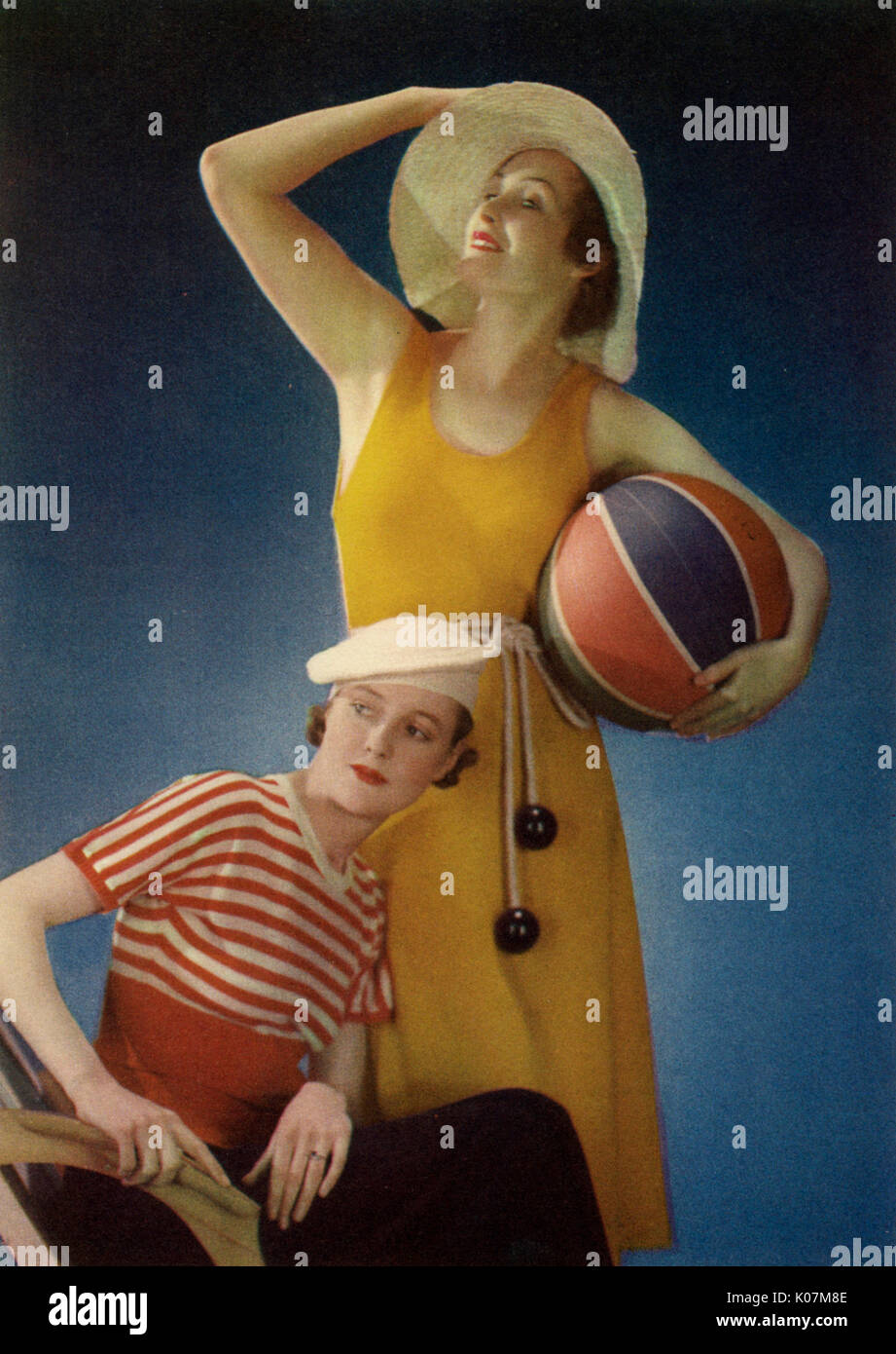 Two models posing in nautical style fashions, popular in the 1930s.     Date: 1934 - Stock Image
