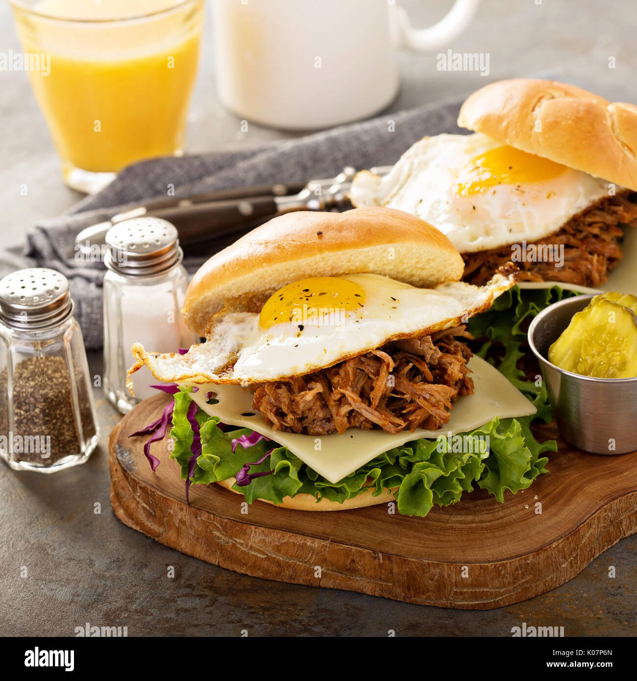 Pulled pork breakfast sandwiches with fried egg - Stock Image