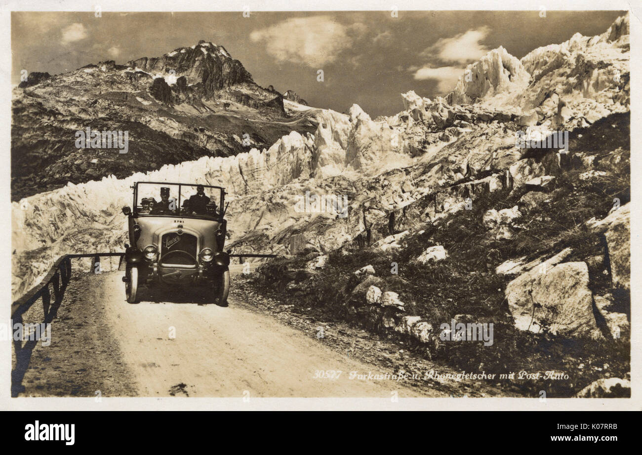 A Saurer open top Post Bus (Swiss rural bus service) navigating the winding Furkastrasse which passes the Rhone Stock Photo