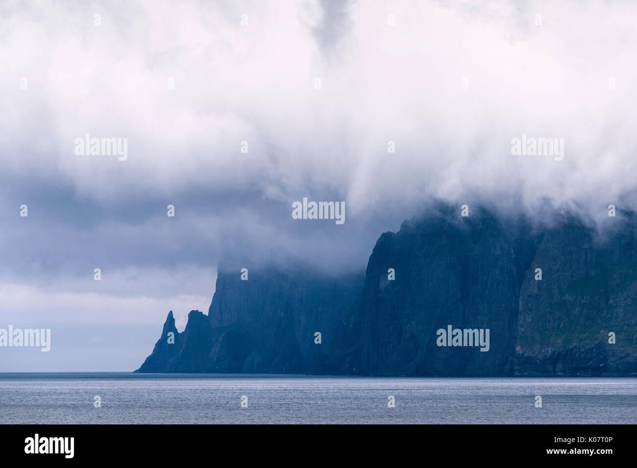 Steep coast near Vestmanna, cloudscape, Streymoy island, Faroe Islands, Denmark - Stock Image