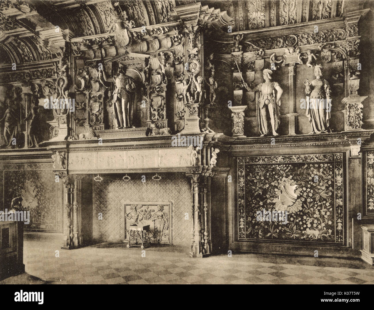 Ornately carved stone fireplace (Cheminee du Franc) in the Palais de Justice, Bruges, Belgium, dating back to the - Stock Image