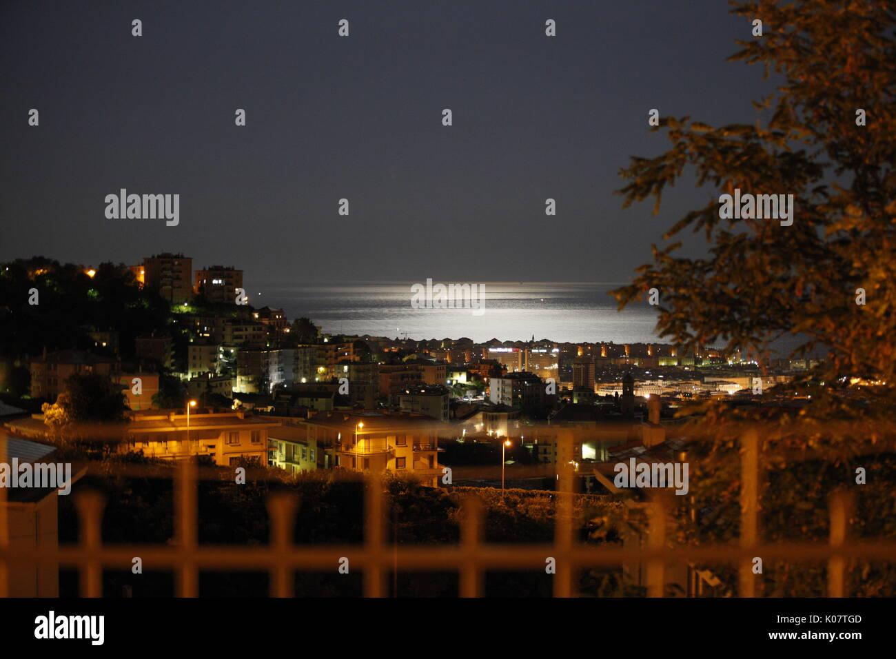 GENOVA/ITALY - 12 AUGUST 2017: night, moonshine, sea,  panorama of the town - Stock Image
