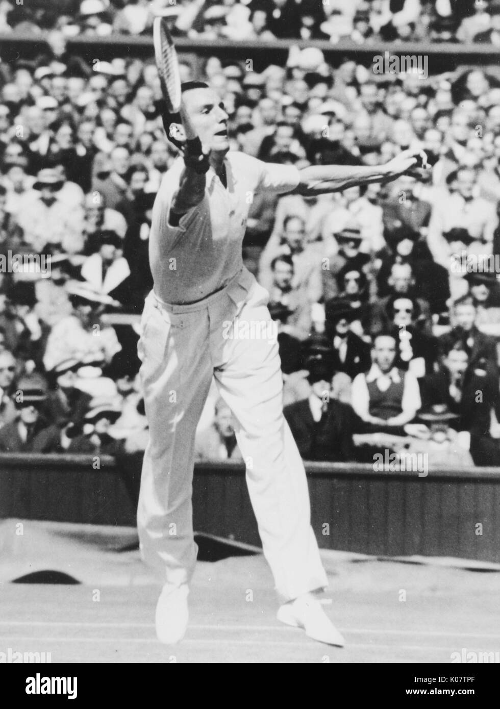 Fred Perry (1909-1995), British tennis player, in action.      Date: circa 1936 - Stock Image