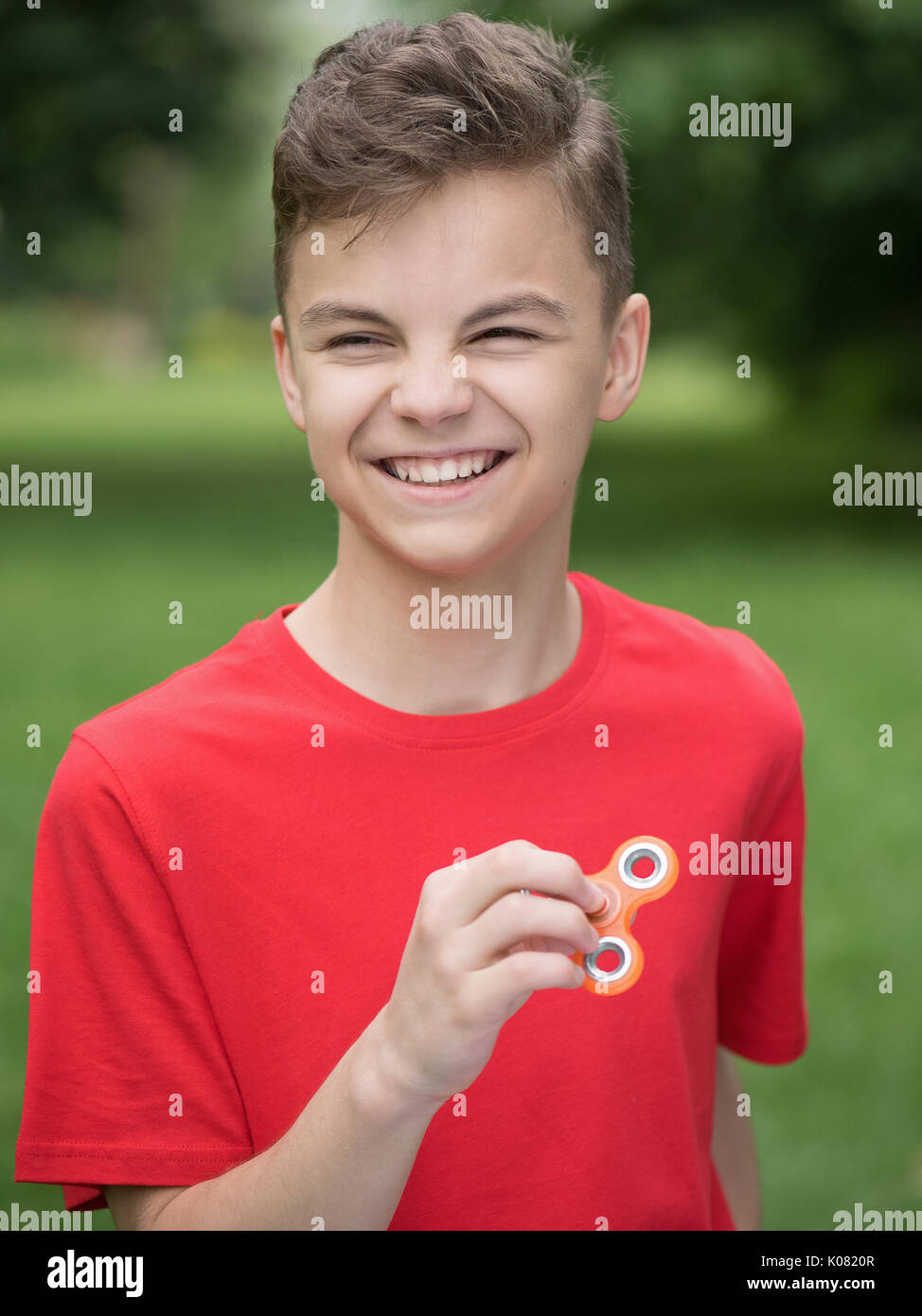 Teen boy with spinner - Stock Image