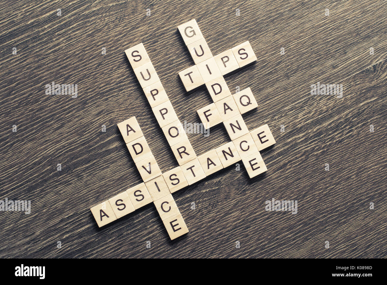 Feedback assistance support guidance words spelled with cubes on - Stock Image