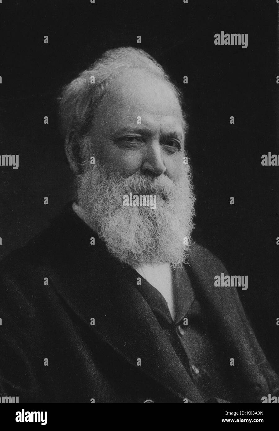 Half length seated portrait of American classical scholar Basil Lanneau Gildersleeve with a neutral expression, 1890. - Stock Image