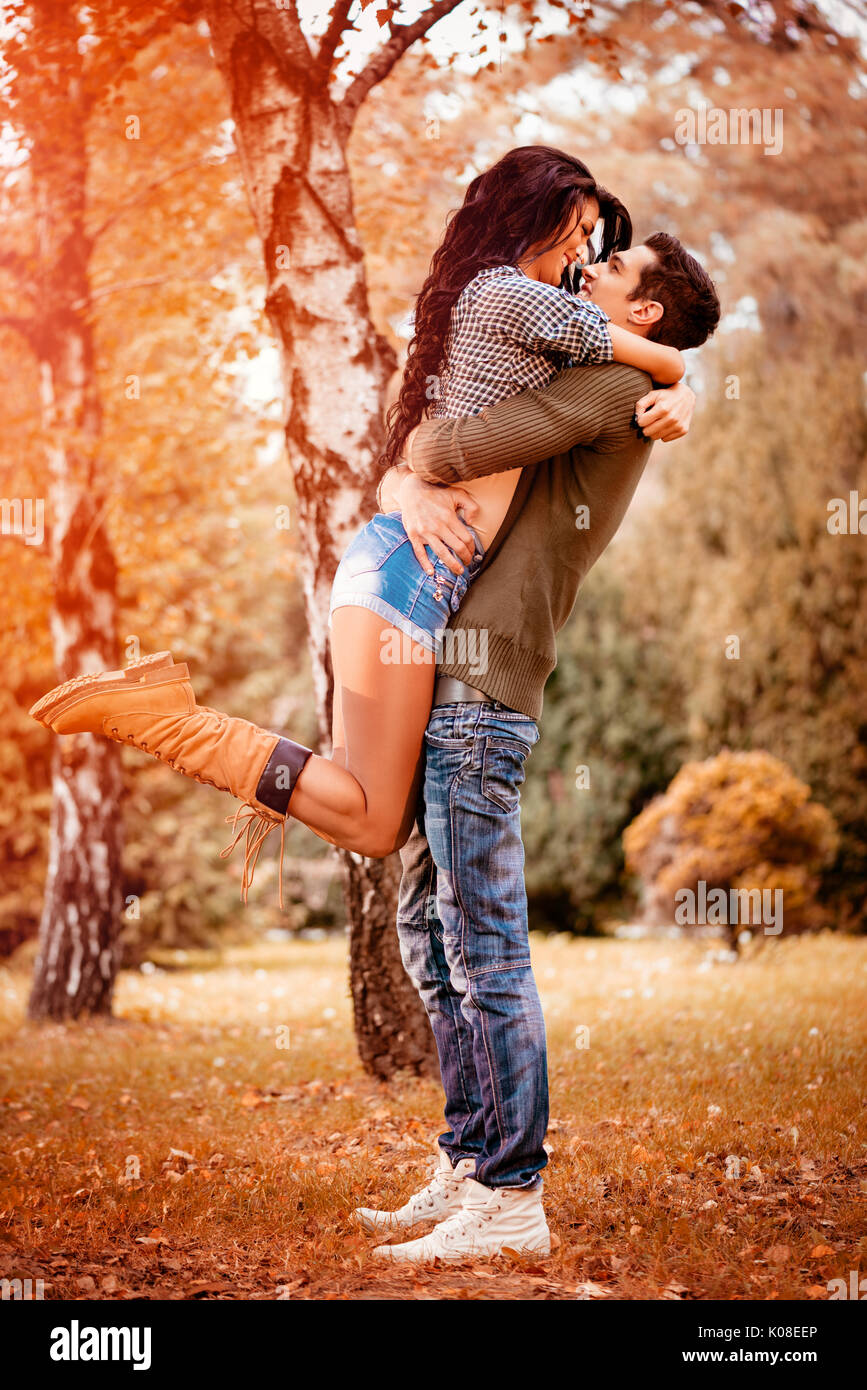Beautiful Lovely Couple Enjoying In Sunny Park In Autumn Colors