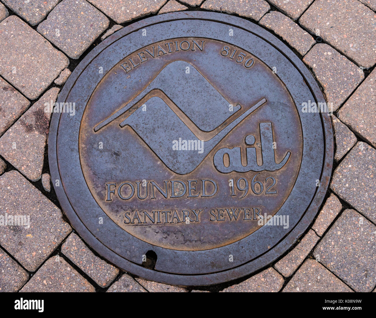 Manhole sewer cover in Vail Colorado USA - Stock Image