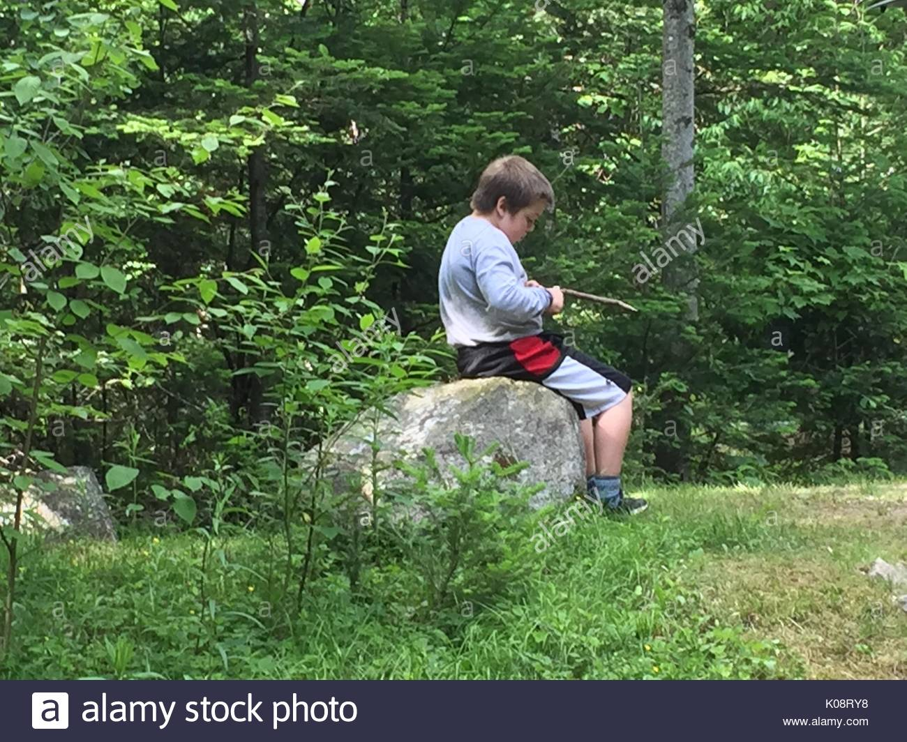 Boy Scout Whittling - Stock Image