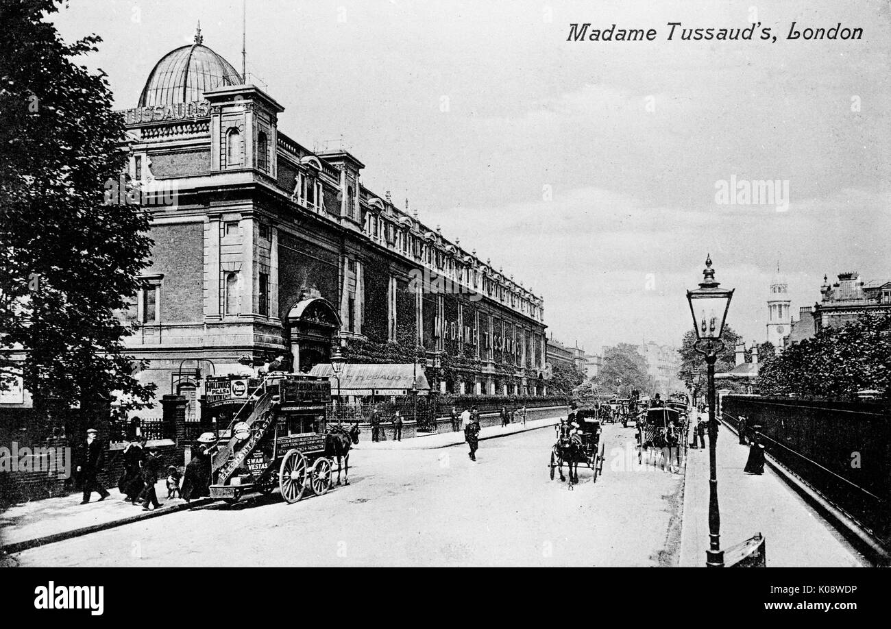 Madame Tussaud's waxwork museum, Marylebone Road, London, with a horse-drawn bus in the road outside.      Date: Stock Photo
