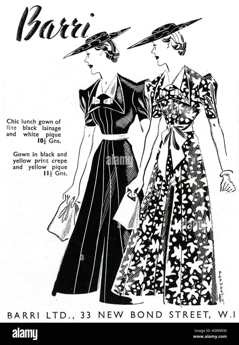 Two women wearing lunch dresses made from crepe print.     Date: 1937 - Stock Image