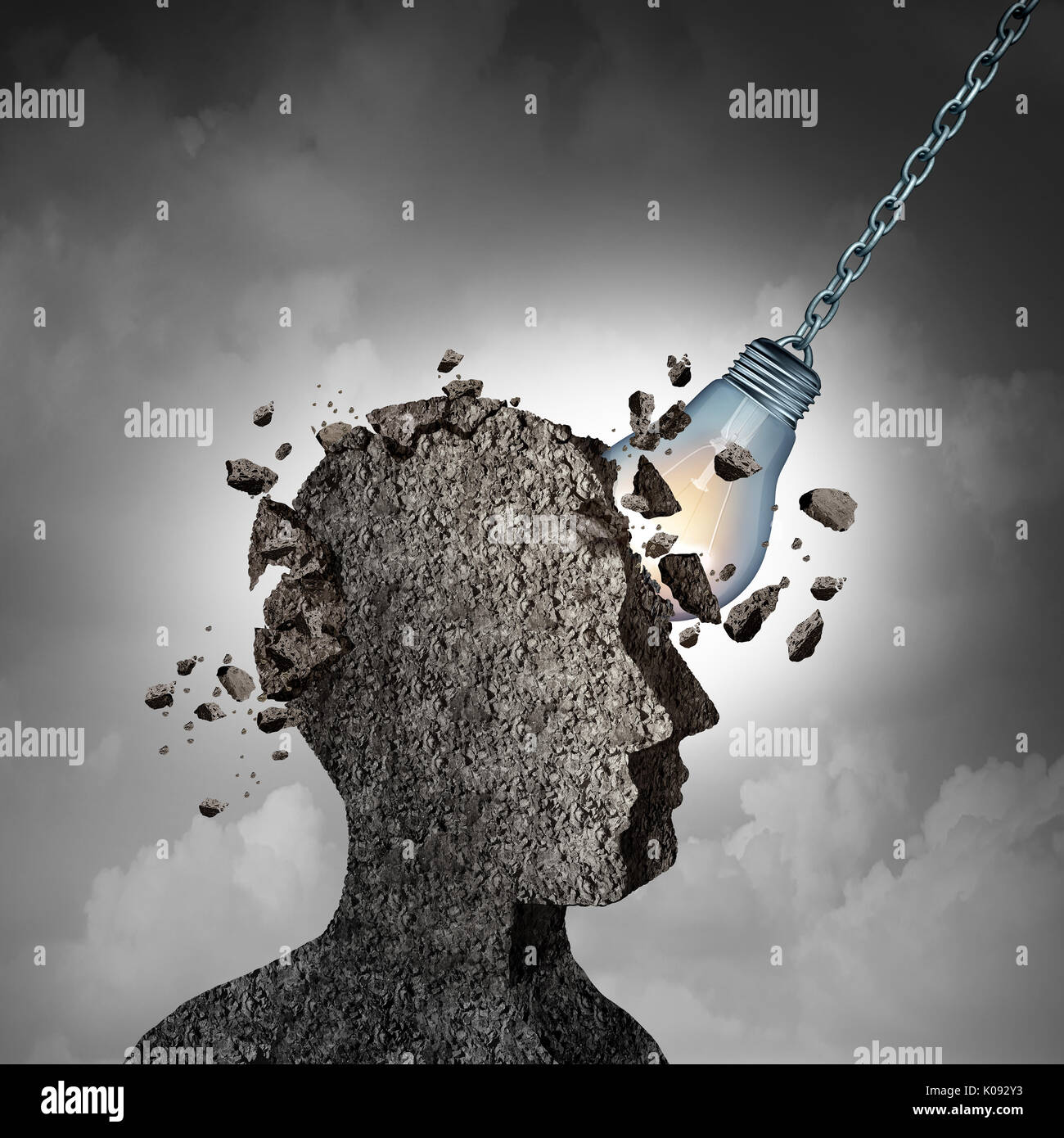 Concept Of Brainstorming and racking your brains idea as a human head made of cement or concrete being demolished by an illuminated lightbulb. - Stock Image