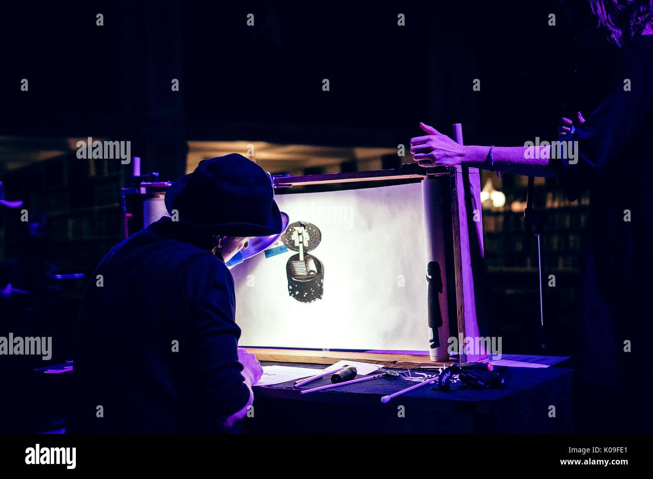 View from behind the screen of the shadow puppet show and the puppeteer, 2015. Courtesy Eric Chen. - Stock Image