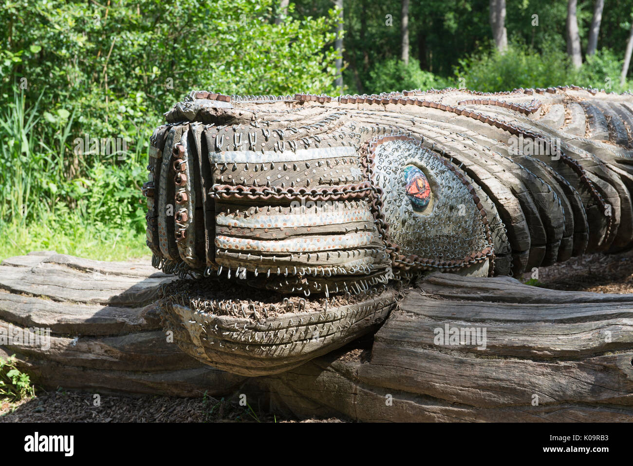 A carved wooden sea monster sculpture  in Tilgate Park, Crawley, West Sussex, England, UK - Stock Image