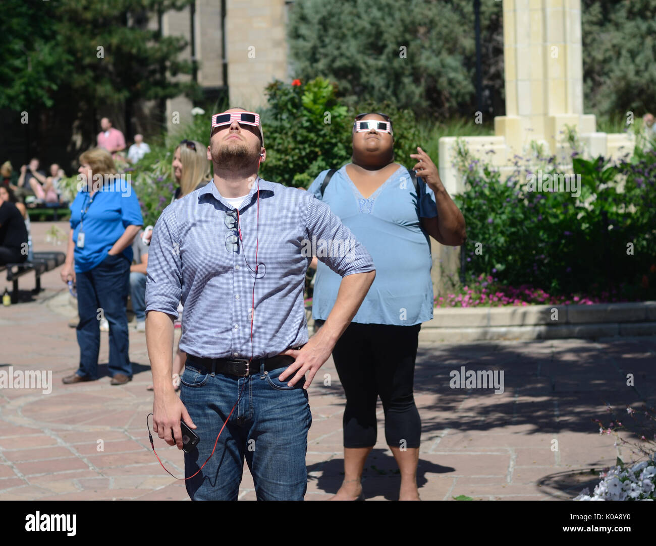 Local  Boulder residents congregated at the Boulder County Courthouse to view the Aur. 21, 2017 solar eclipse. About 92 percent of sun was covered. - Stock Image