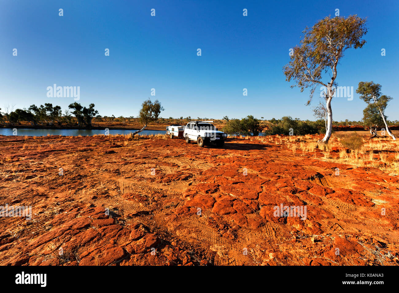 Rocky Pool with 4wd motor vehicle and camper,a section of the Gascoyne River that never becomes dry, Gascoyne, Western Australia - Stock Image