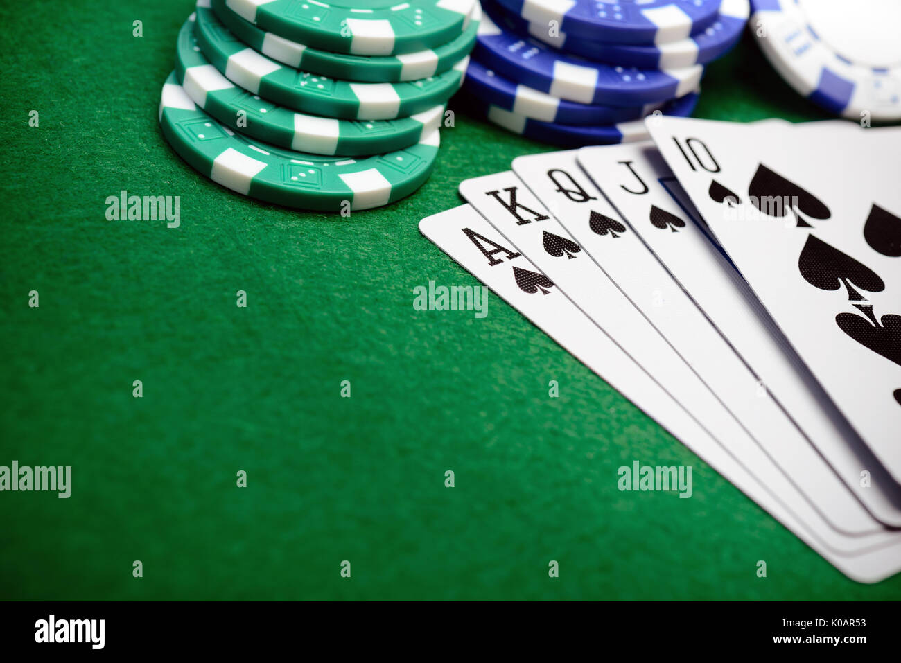 Poker chips and a straight flush card hand with copy space for your text - Stock Image