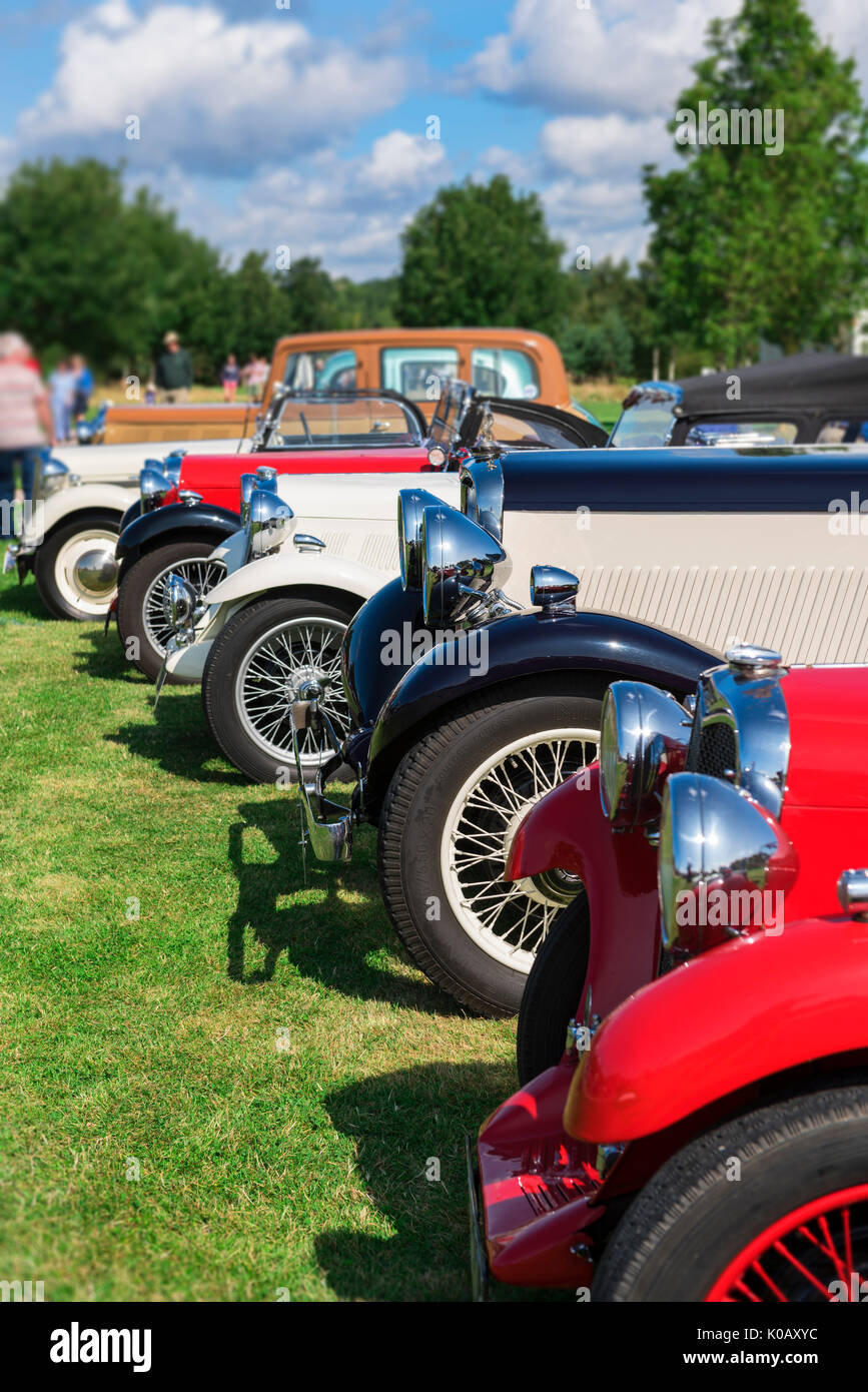 Row of vintage Singer classic cars. - Stock Image