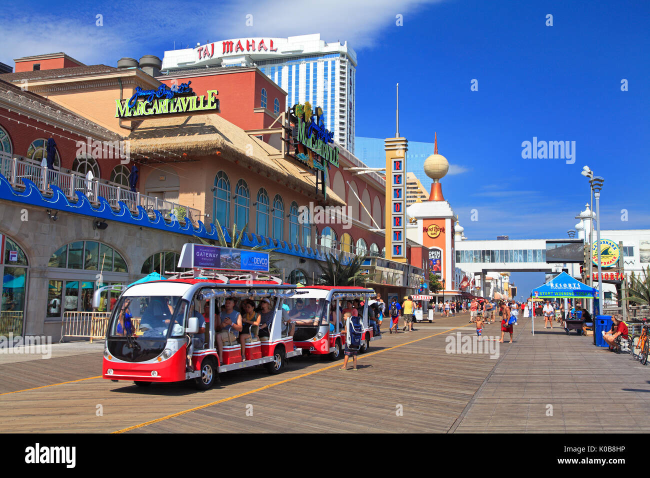 ATLANTIC CITY, NEW JERSEY - AUGUST 19, 2017: Tourists traveling on the boardwalk in Atlantic City. Established in the 1800s as a health resort, today - Stock Image
