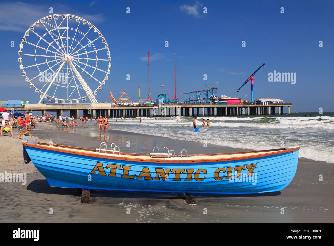 ATLANTIC CITY, NEW JERSEY - AUGUST 19, 2017: Boat lifeguard, beach and steel Pier in Atlantic City. Established in the 1800s as a health resort, today - Stock Image