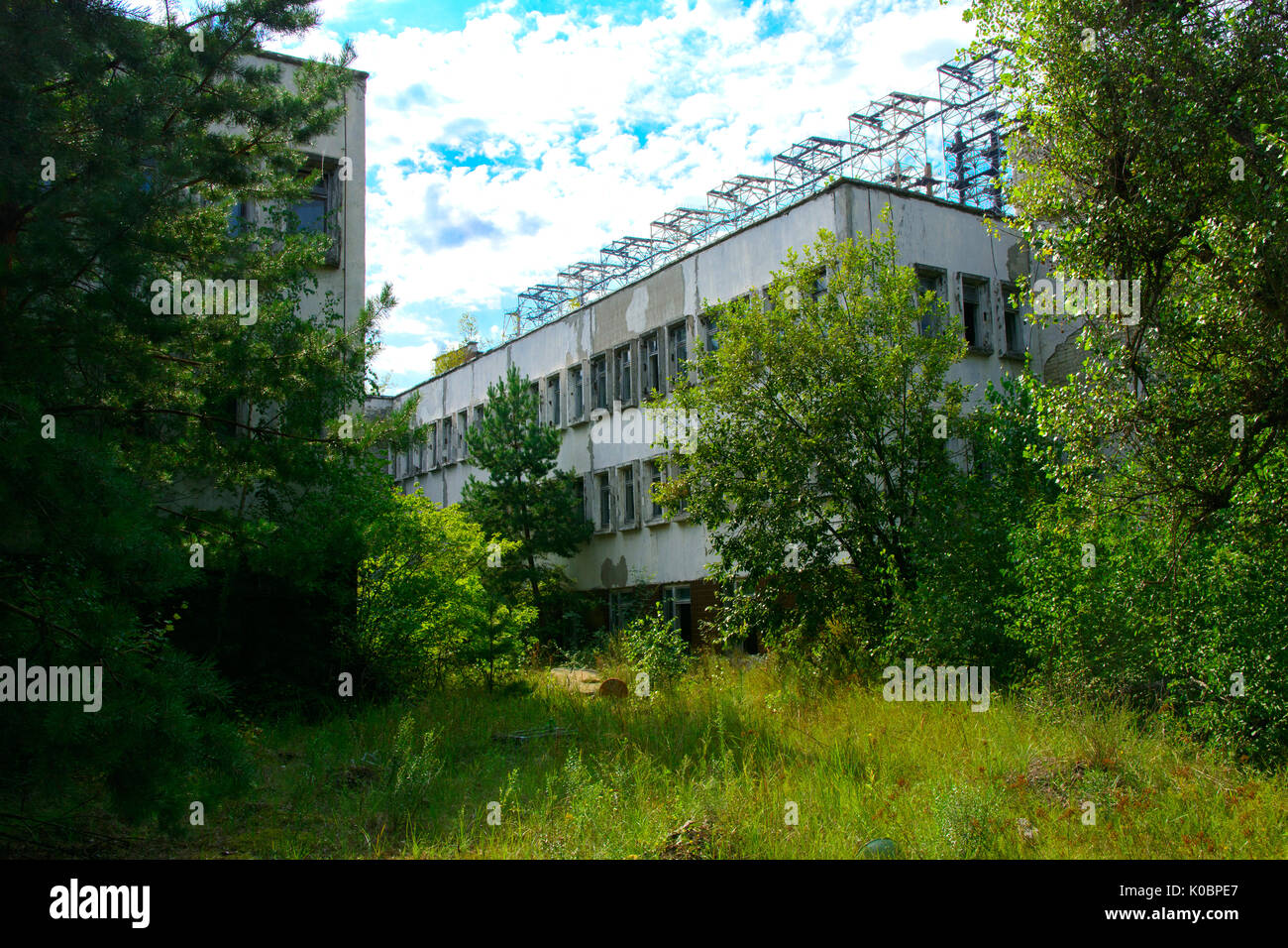 Destroyed buildings in the exclusion zone. Dead military unit. Consequences of the Chernobyl nuclear disaster, August 2017. - Stock Image