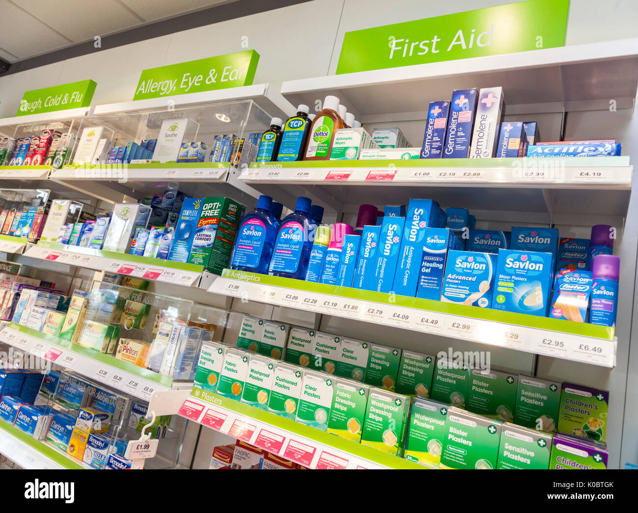 Cough,cold,flu remedies,allergy products,first aid on display in a chemist shop,pharmacy shelf,pharmacists,drug store - Stock Image