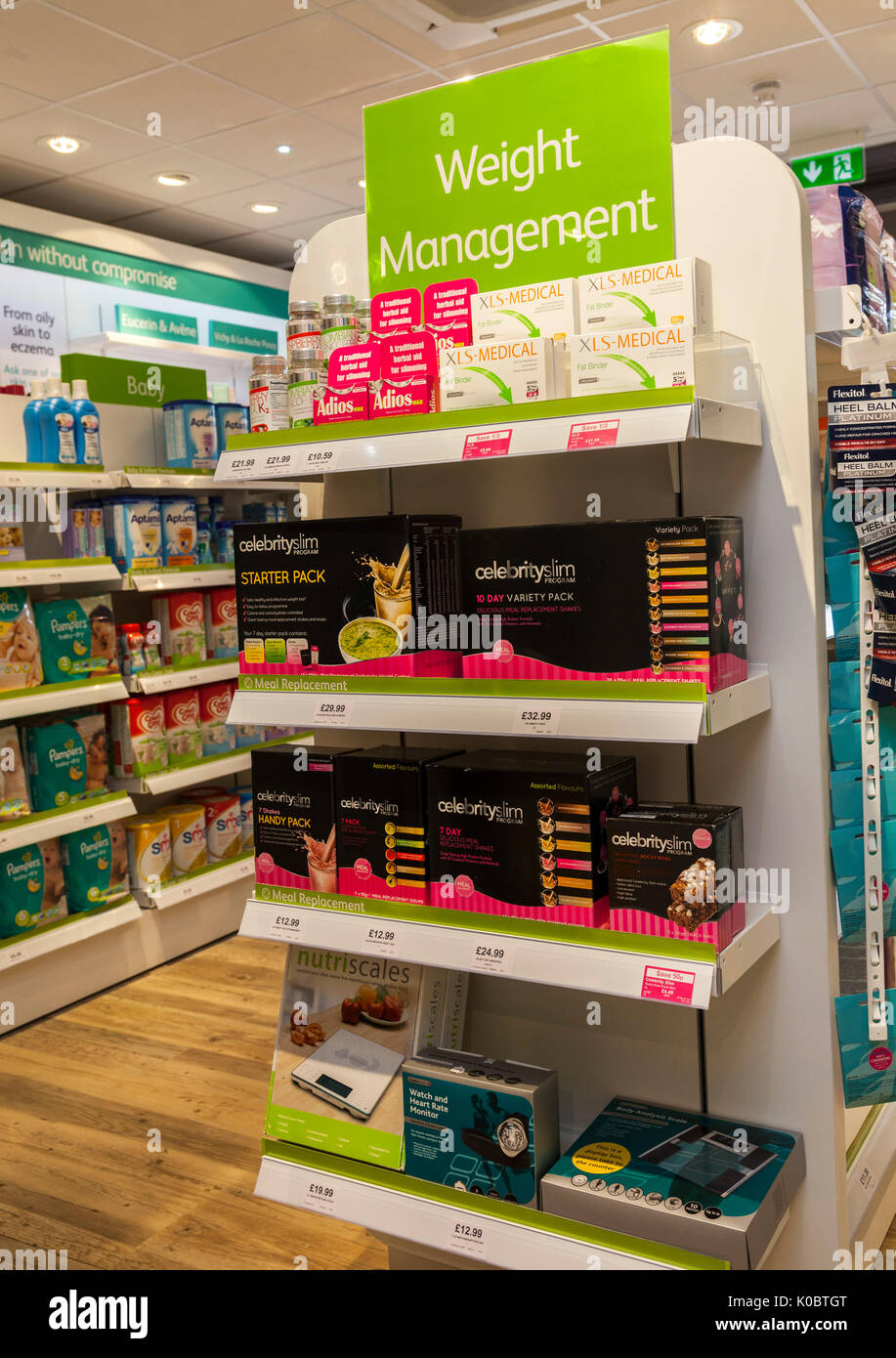 Weight management products in a chemist shop,pharmacy shelf,pharmacists,drug store. Celebrity slim, - Stock Image