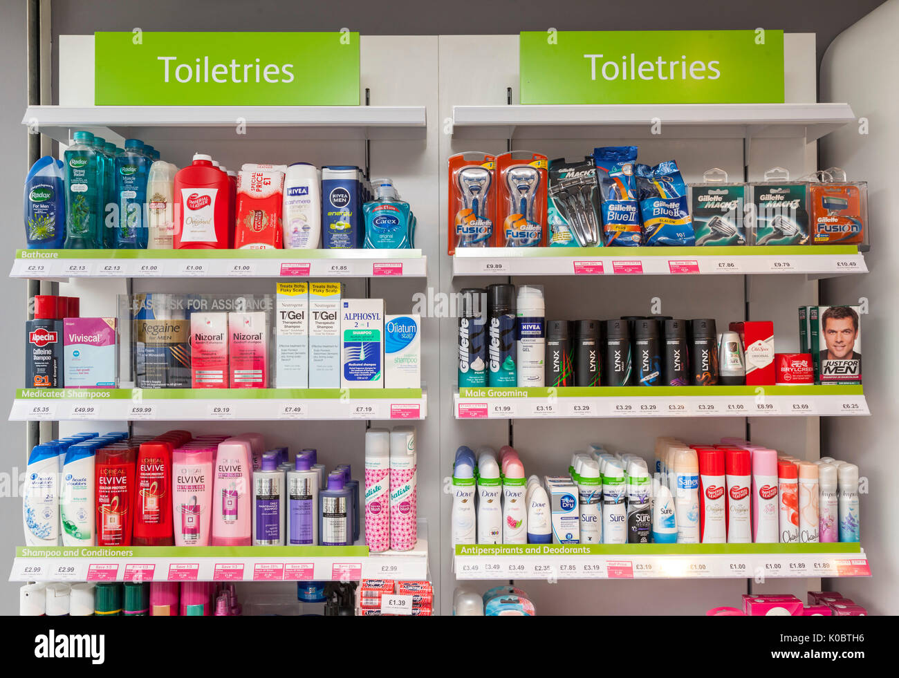 Toliteries on display in a chemist shop,pharmacy shelf,pharmacists,drug store - Stock Image