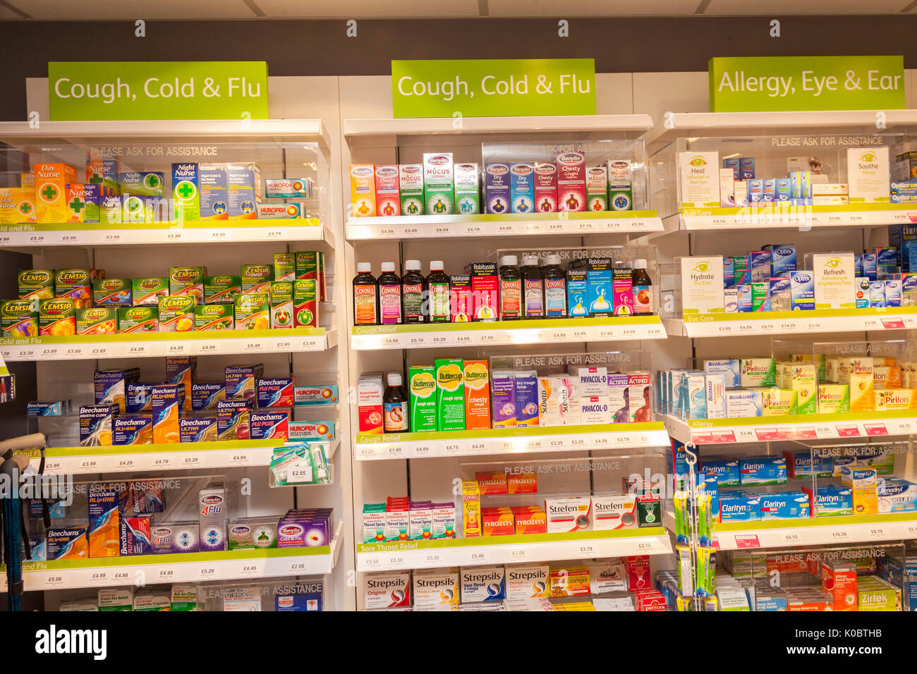 Cough cold and flu remedies in a chemist shop,pharmacy shelf,pharmacists,drug store - Stock Image