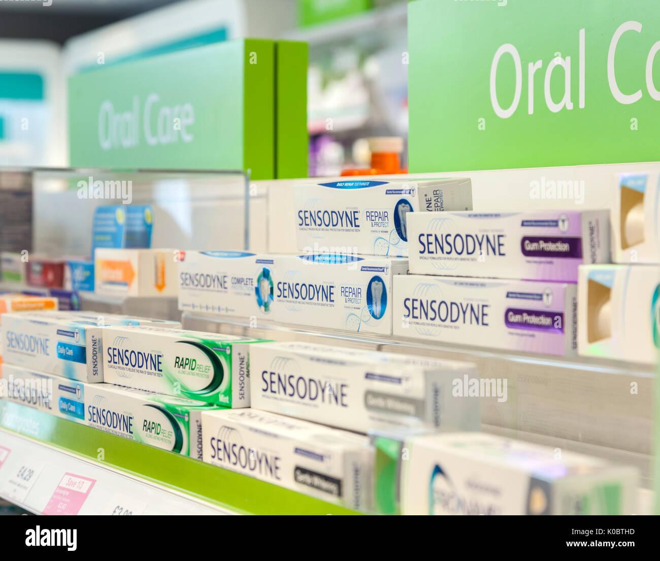 Sensodyne products on sale in a chemist shop,pharmacy shelf,pharmacists,drug store - Stock Image
