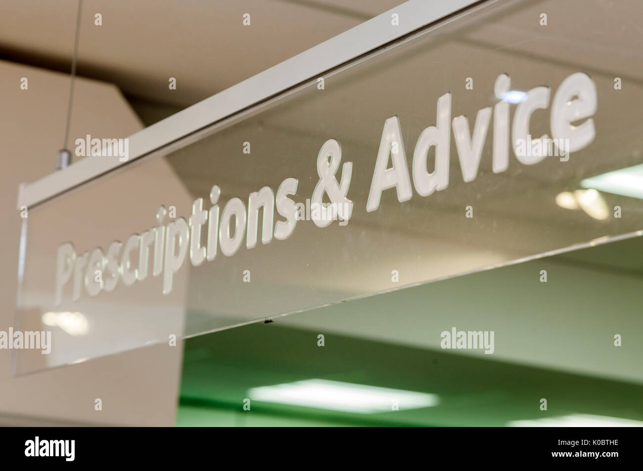 Prescriptions and advice sign in a chemist shop,pharmacy shelf,pharmacists,drug store - Stock Image