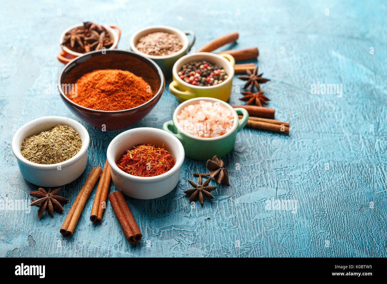 Dry colorful spices and condiments anise, paprika, saffron, pepper ...