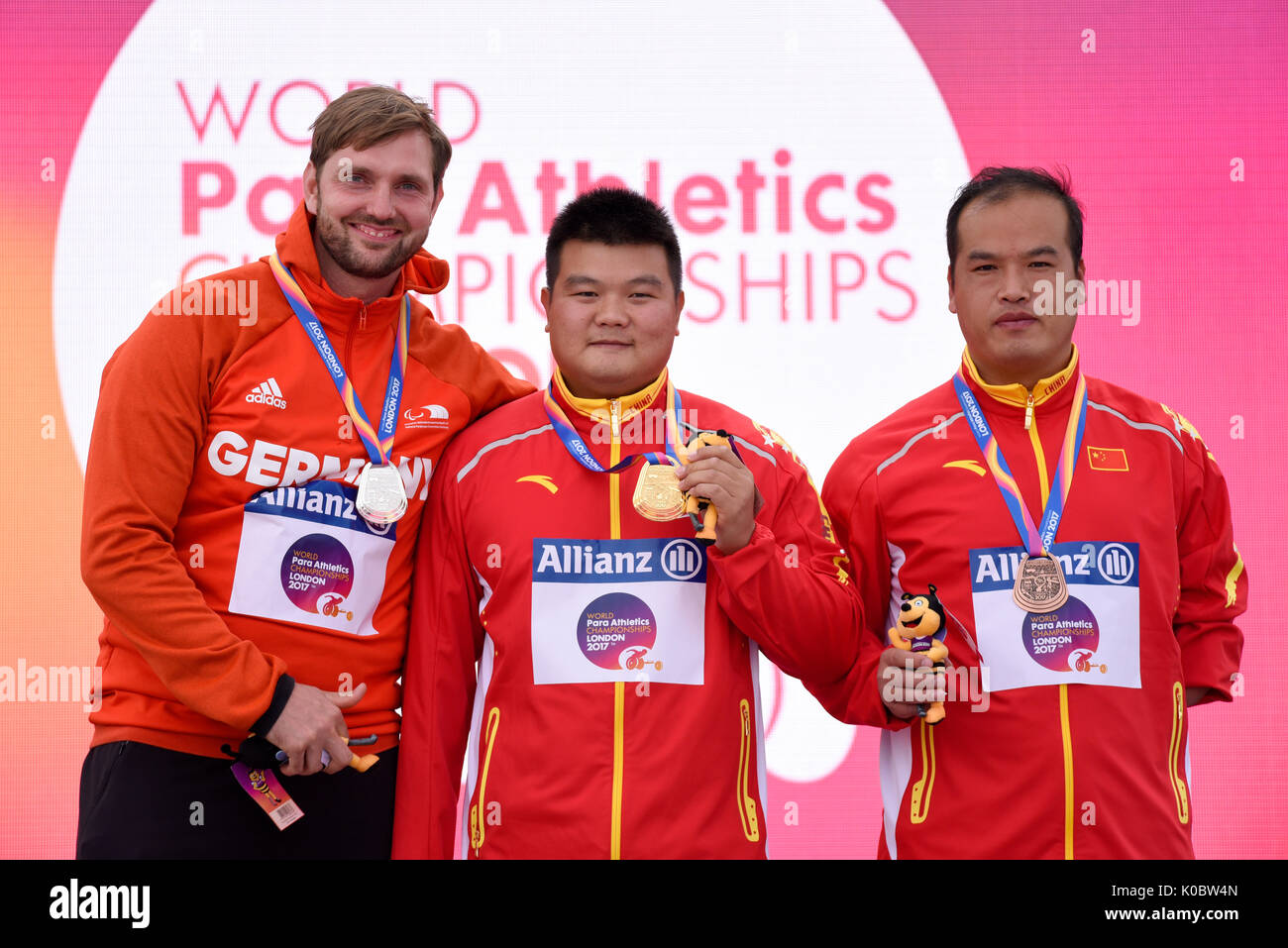 Enlong Wei, Mathias Uwe Schulze, Zhanbiao Hou at the medal ceremony for the F46 shot put at the World Para Athletics Championships, London - Stock Image