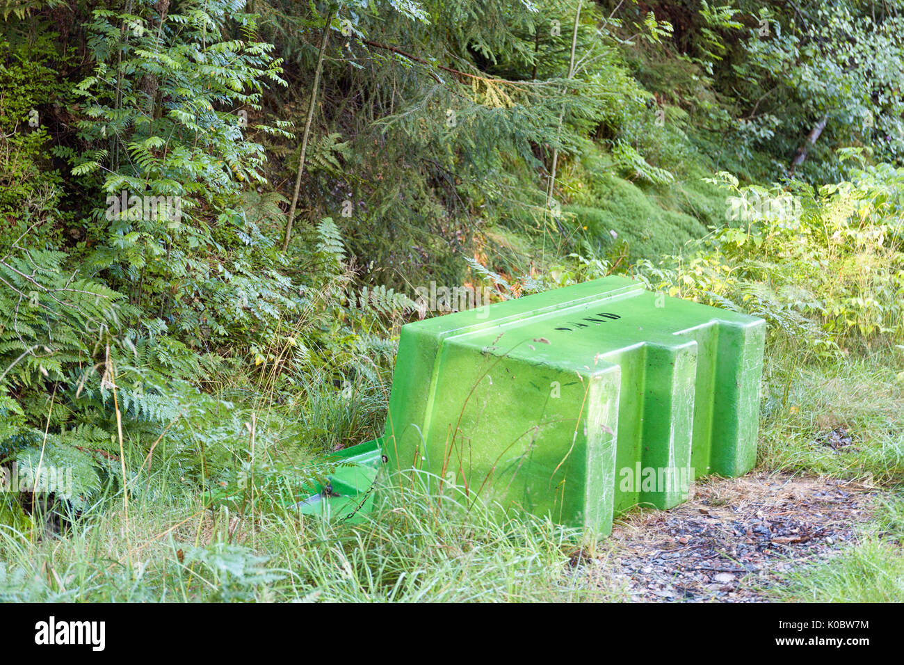 Overturned and emptied green sand grit bin box  Model Release: No.  Property Release: No. - Stock Image