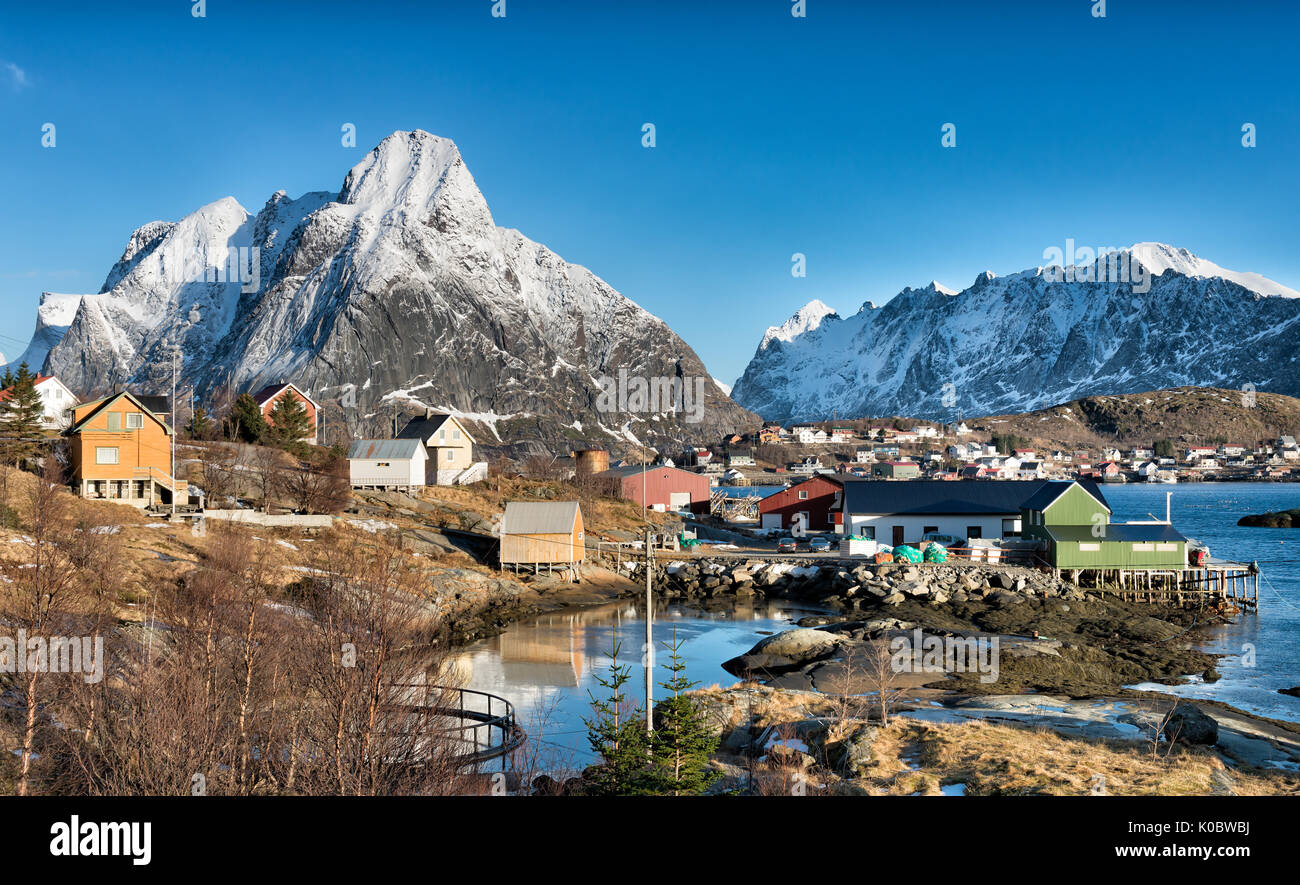 Mount Olstind with Reine town in the foreground Stock Photo