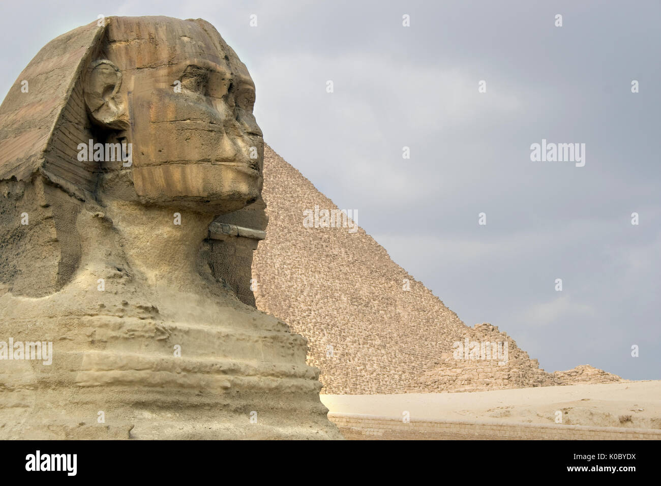 The Sphinx guarding the pyramids on the Giza plateu in Cairo, egypt. - Stock Image