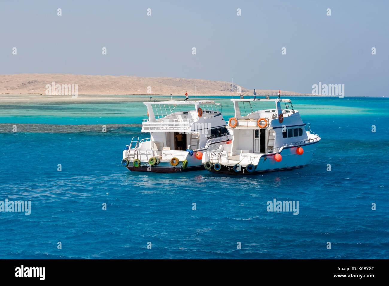 two yachts anchored outside Giftin Island in the Red Sea, a popular tourist destintion - Stock Image