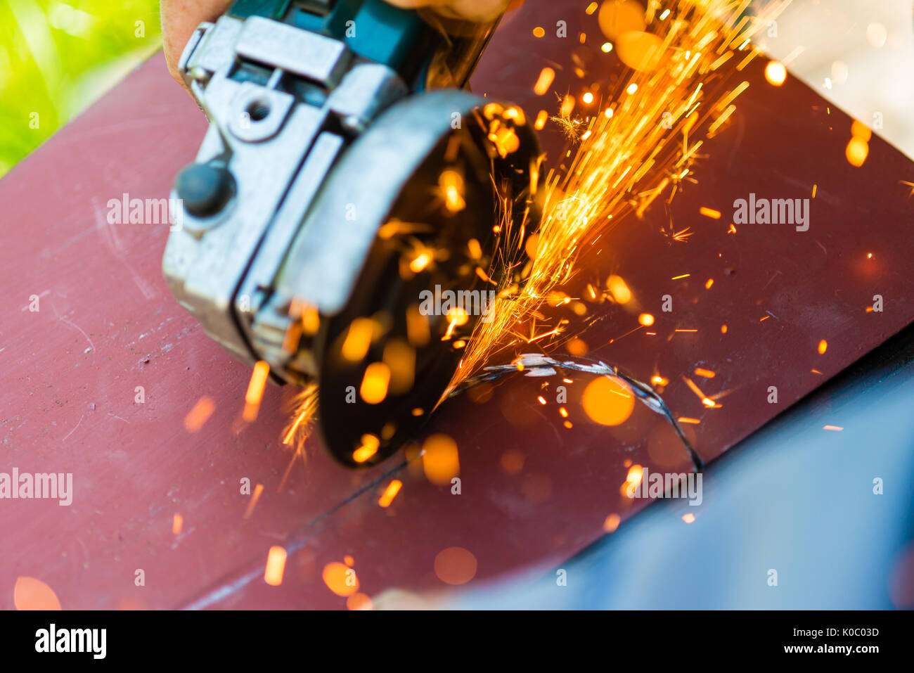 metal sawing with angle grinder close up - Stock Image