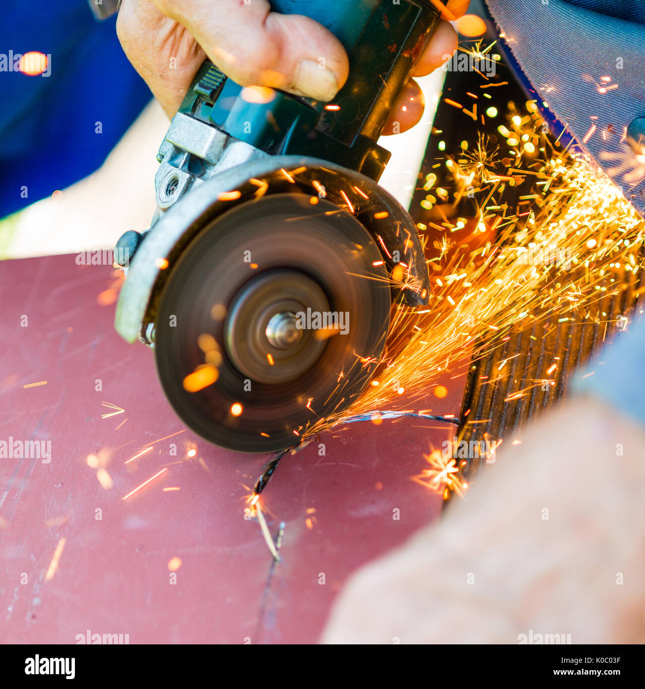 metal sawing with grinder close up - Stock Image