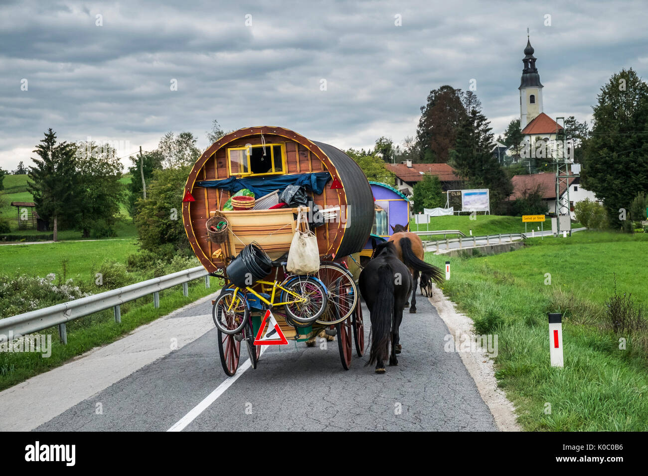 Horse drawn wagon on the road in central Slovenia - Stock Image