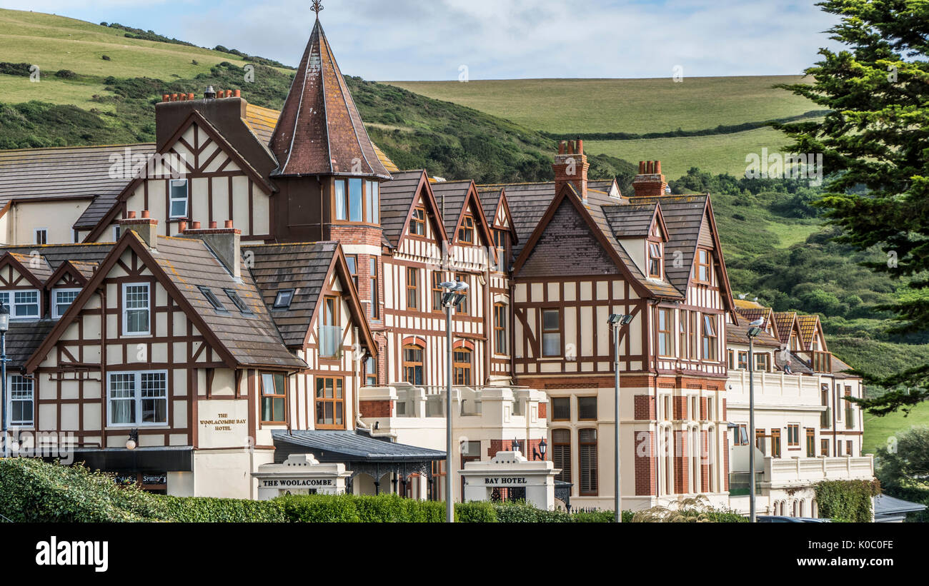 Striking architecture of historic Woolacombe Bay Hotel (built 1880s), with hills in the background. Woolacombe, on the North Devon coast, England, UK. - Stock Image