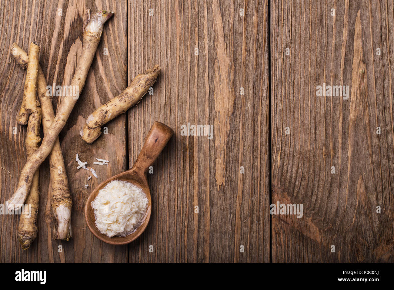 Seasoning of grated horseradish with space for text - Stock Image