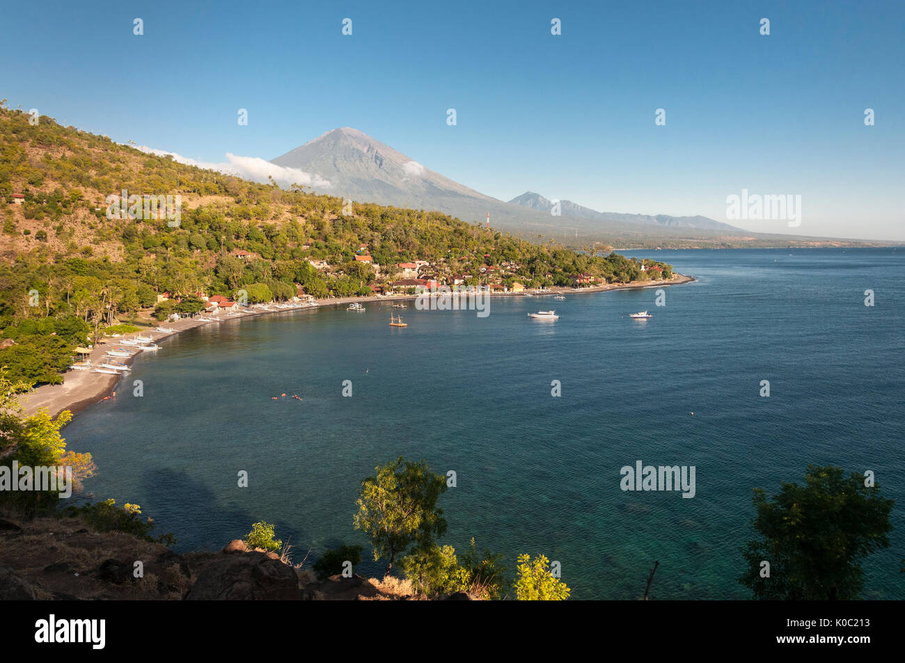 Looking across Jemeluk bay at Amed  with Gunung Agung volcano in the background, Eastern Bali, Indonesia. - Stock Image