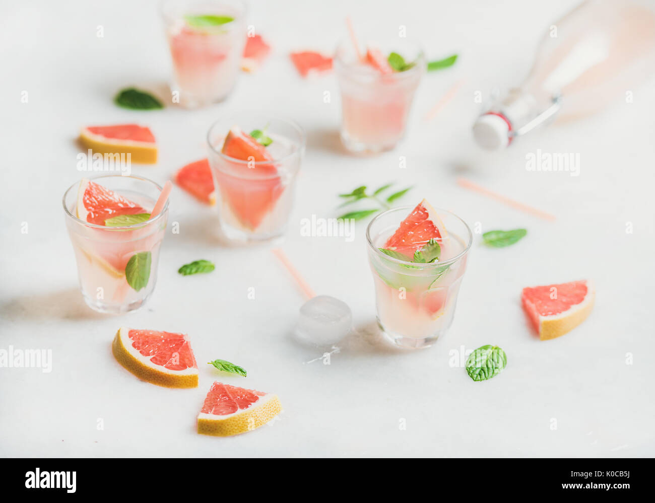 Cold refreshing summer alcohol cocktail with fresh grapefruit pieces - Stock Image