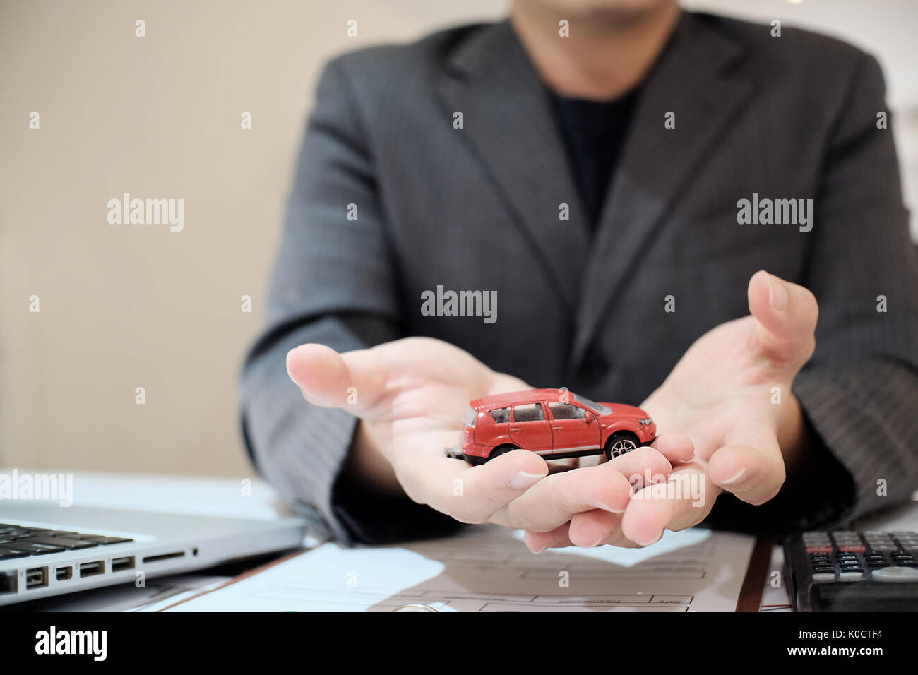 Sale man agent present a car in showroom, sale car concept. - Stock Image