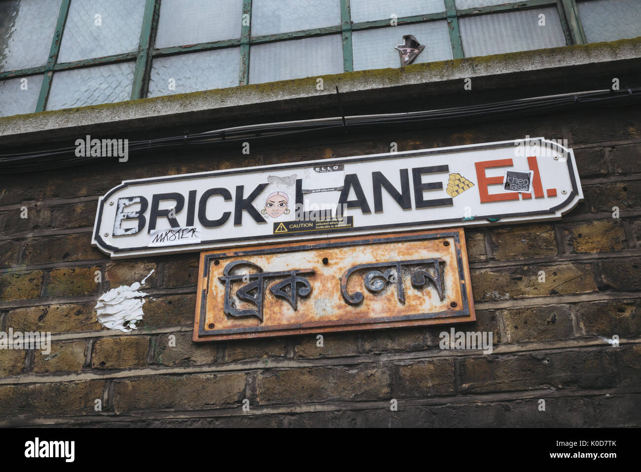 Brick Lane street sign in English and Bengali. The street is the heart of the London's Bangladeshi-Sylheti community and is famous for its many curry - Stock Image