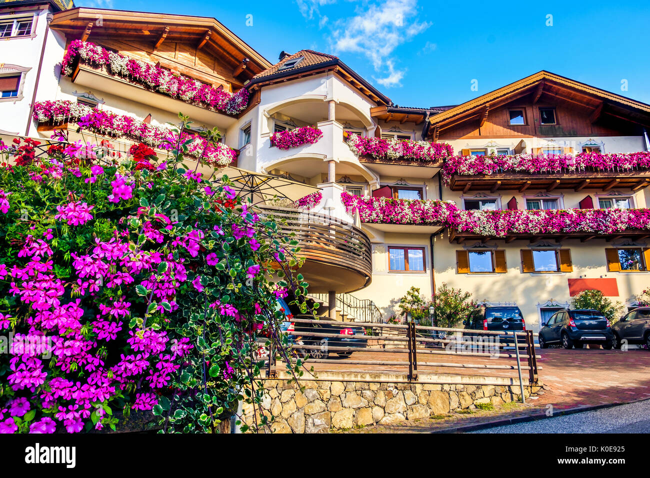 chalet purple flowers colorful summer south tyrol accomodation - Stock Image